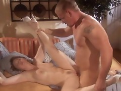 Sunny Lane lowers herself onto a waiting cock and is showered in jizz