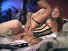 Sex in a corset sexy boots and fishnet stockings
