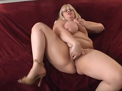 Big beautiful woman Tiffany Blake covers a cock whole in this vid