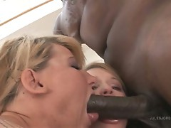 Casey Cumz and Heather Starlet take tunrs on a very large cock