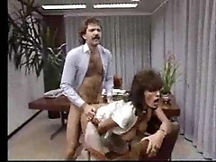 Office slut's coocie is creampied in vintage porn