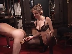 Sexy dominatrix tortures balls of a blinded guy