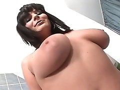 Busty brunet Nancy lifts leg for deep penetration