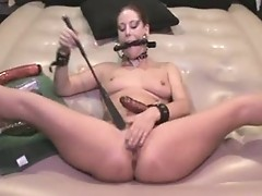 Gagged Antonia masturbates with dildo & pistil