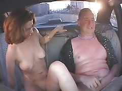 Drunk couple going wild in the taxi cab - snake