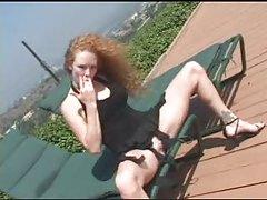 Hottie redhead masturbating outdoors