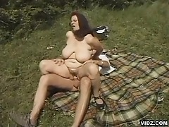 Naughty granny let horny stud pound her in grassy outdoor