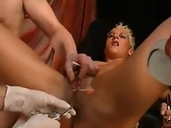 Shorthaired blonde mom spreads legs to get pussy fisted on bizarre fisting porn