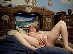 Ashley plays with a dildo
