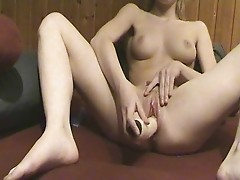 Young Girl Toys With Her Pussy