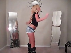 Hot Blonde Babe in Hot Pants And Boots Dancing
