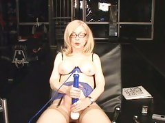 Slutty MILF Nina Hartley torments her twat with a toy