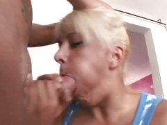 Gorgeous blonde chokes on a massive fuck stick