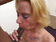 Whore Miss Dee eating a long black flesh tube