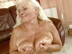 Old bitch Judi taking huge cum load all over tits
