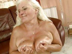 Old bitch Judi taking huge cum load all over tits