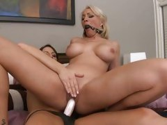 Horny Lexi Swallow rides Kortney Kane's strap on