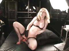 Nina Hartley with gloves fingering her cunt