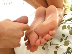 Allie Haze gets kinky with her feet until her man explodes all over them