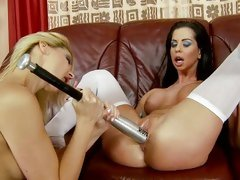 Alluring Cindy Hope stuffs a bat into Larissa Dee