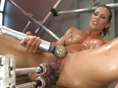 Ariel Carmine double dicked by a dildo machine