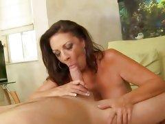 Lusty Margo Sullivan wraps her lips round a thick cock