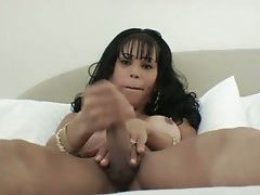 Hot shemale babe jerks her own shemale cock !