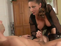 Guys is bound and strapped to chair and gets handjob by dommie