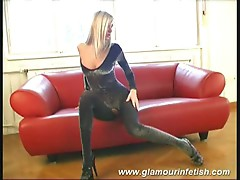 Sophie masturbates herself on a red sofa