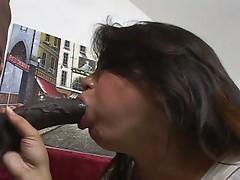 Busty Asian babe sucks a big black cock
