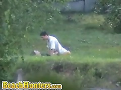 Horny couple having sex on grass caught on camera