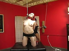 Redhead babe slaved by her master