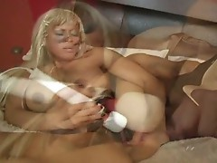 Busty blonde masturbates herself with some sex toy
