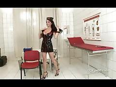 Nurse in latex dress showing big tits