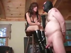Girl in rubber dress abuses his cock