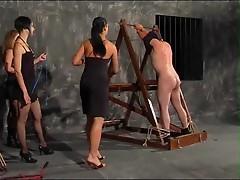 Three ladies take turns smacking him