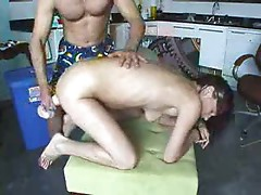Stuffing his GF with a giant dildo