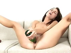 brunette with big bottle in pussy