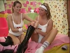 Girl in hot boots in a lesbian scene