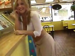 Cute blonde in public wearing almost nothing