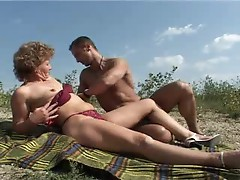 Mature outdoors rides a big dick