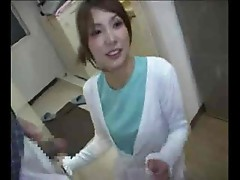 Fully dressed Japanese girl giving secret blowjob