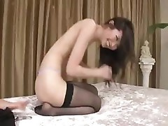 Sexy Asian in stocking gives a nice blowjob before fucking him