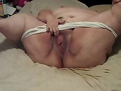 Big chubby granny is rubbing her shaved pussy hard to get off