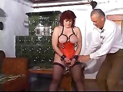 Mature lady has pierced nipples and pussy in some strange sex