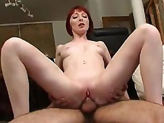 Jolie Rouquine is getting poked and probed by a hard long cock