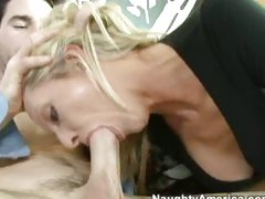 Sexy MILF Emma Starr fills her sweet mouth with a big fat dick