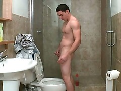 Hot muscled guy jerking under shower