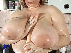 Voluptuous busty copulates with dildo
