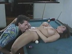 Man doxy Peter North pLeases a sexy slut naked on the table for some fucking